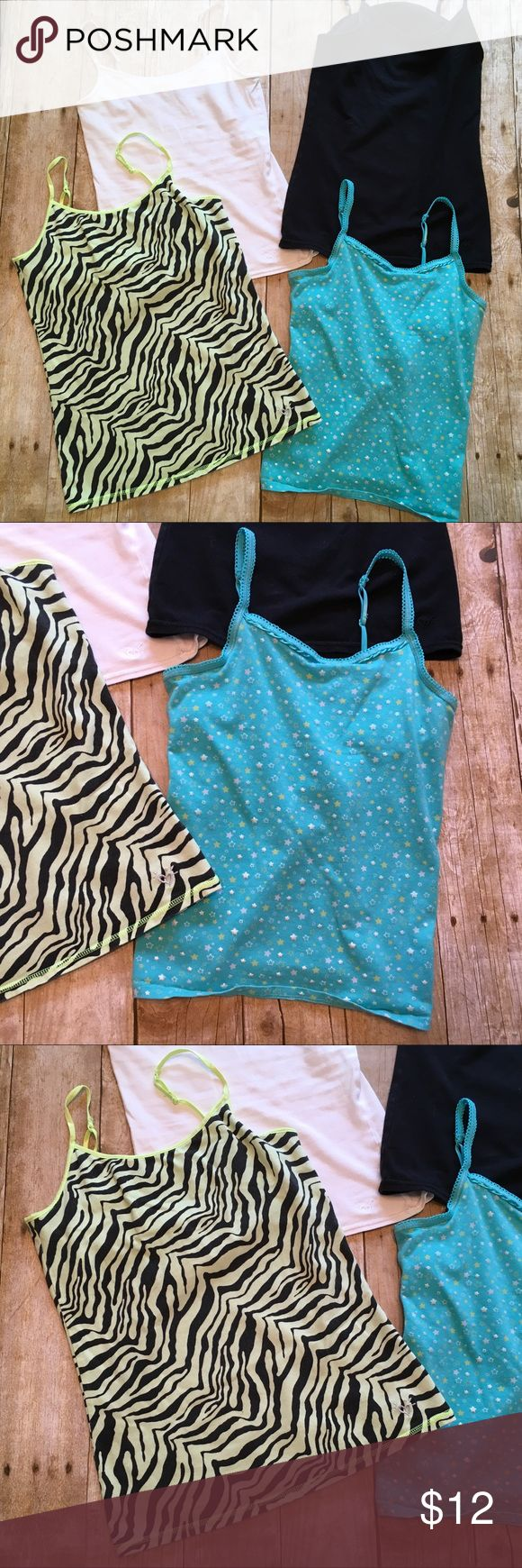 Bundle of four girls Camis ❤️Description: 4 girls camis , black white and blue cami size 10/12, neon yellow animal print cami size 14. All four have built in bra ❤️Condition: excellent used ❤️Brand: Black, white, animal print justice; blue, SO ❤️Size: 10/12, 14 ❤️Color(s): Black, white, blue, neon yellow ❤️Materials: 95% cotton/5% spandex ❤️Notes: 💕Bundle & save!💕 💕All reasonable offers are considered!💕 Justice Shirts & Tops Camisoles