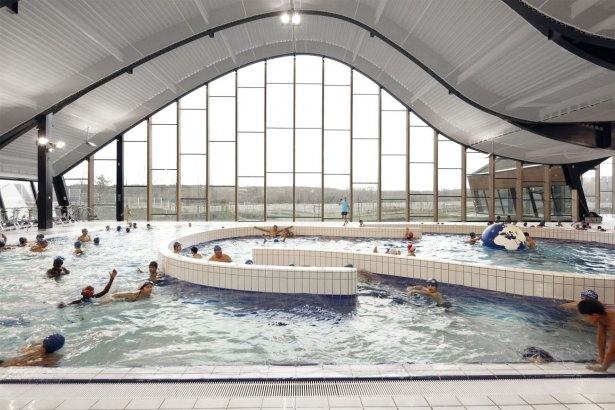 The fantastically curvy Mantes-La-Jolie Water Sports Center in Paris, France.