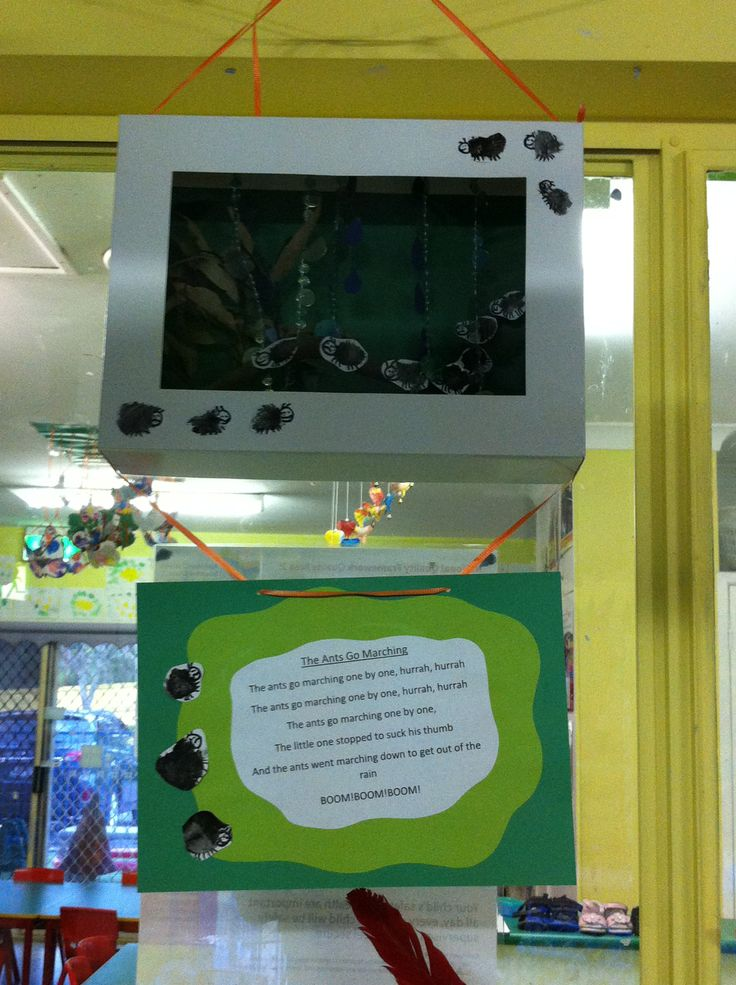 "A shadow box we made at work of ""The ants go marching one by one"". We used a cupcake box from one of the children's birthdays as the shadow box, recycled door beads as rain, leaves and sticks from the bush for the ants to climb up and the ants are black finger prints the children made."