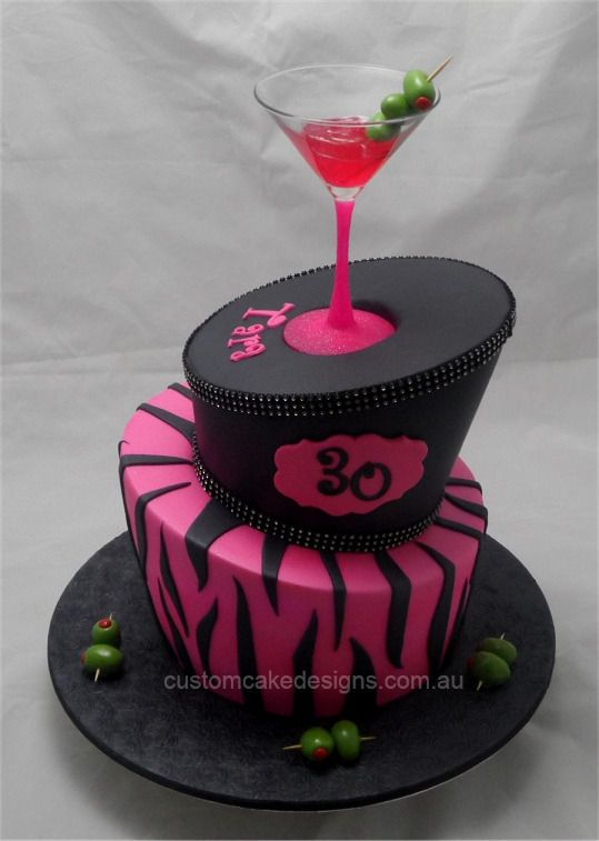 This 2 tier topsy turvy cake was made for a 30th Cocktail themed birthday party. The birthday girl wanted a pink and black zebra theme with some 'bling'. The top tier is red velvet and the bottom is choc mud