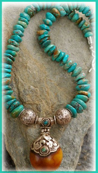 UnEarthed Beaut Necklace... IN THE MIX A stunning Nepalese handcrafted pendant of sterling silver & amber with two turquoise cabochons. Hammered Hilltribe silver beads & toggle. This turquoise is from Kingman, Arizona. It has a beautiful golden brown matrix... The hammered Hilltribe silver beads are 14mm. The pendant is two inches in length measuring from the top of it's tubular silver bail. The pendant is also hinged just below the bail. necklace measures 19.0 inches