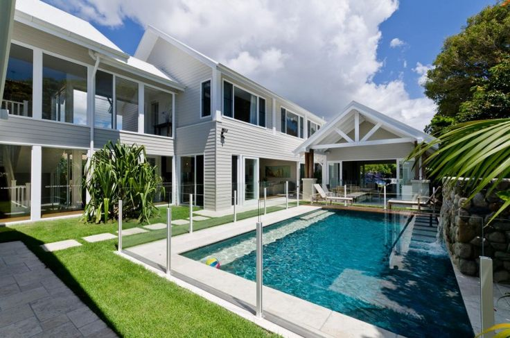 Grey and white house and pool house.  Southport Residence by BGD Architects 01