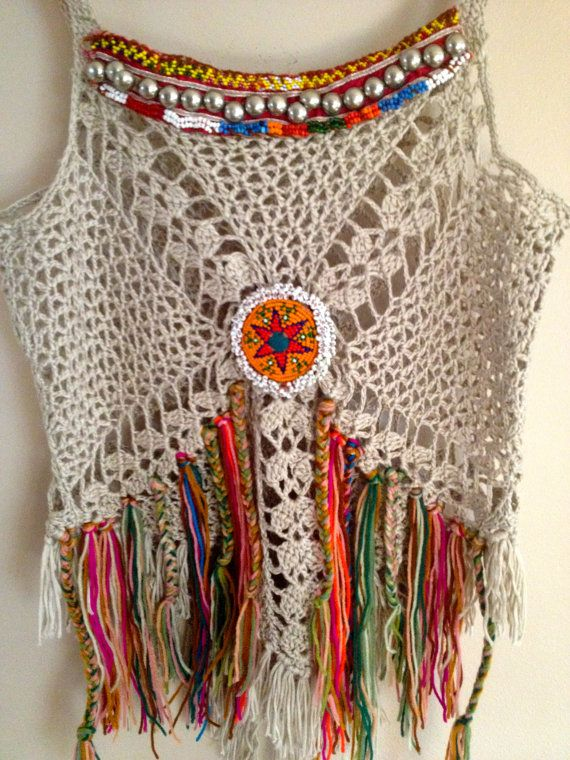 This top made of 100 % cotton fabric is stretch, decorate with vintage jewelry. in the front is higher that the back about 1 inches,    Measurements,  Bust 30 inches stretch up to 40 inches around  Length 21 inches including a fringe.    Care  Hand wash best