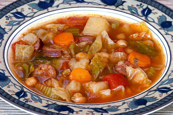 Linguica, ham hocks, potatoes, chick peas, carrots, celery, cabbage, stewed tomatoes garlic and spices in a slow-cooked flavorful broth.