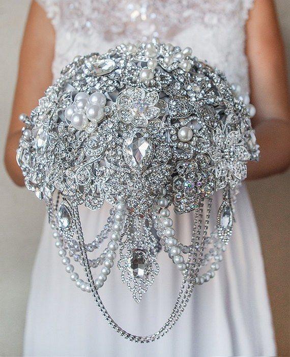 silver cascading brooch wedding bouquet / http://www.deerpearlflowers.com/bling-brooch-wedding-bouquets/