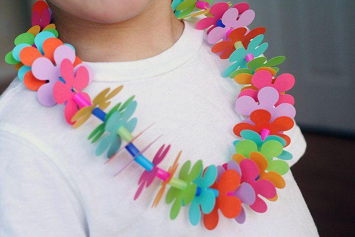 DIY kids craft: leis for a Luau using Fiskars flower punch, string and cut straws