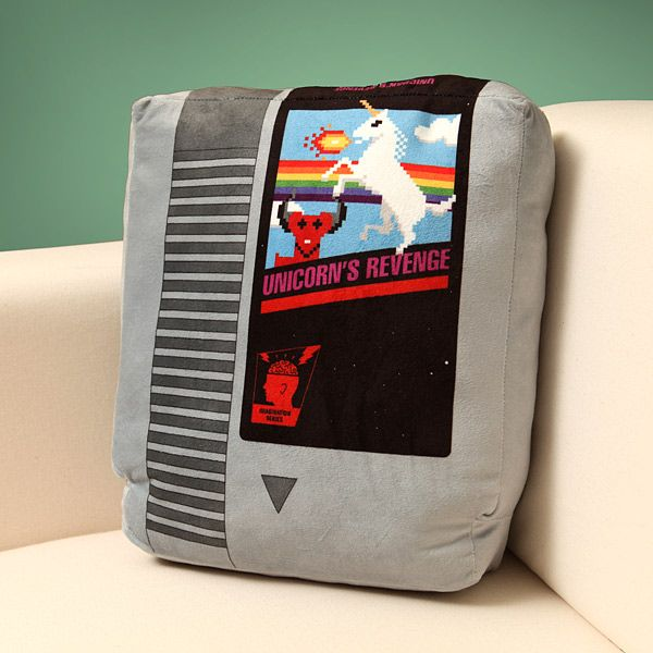 Snuggle up with these plush retro video game cartridges made for true video game geeks. Comes in a set of two, with different games in each set