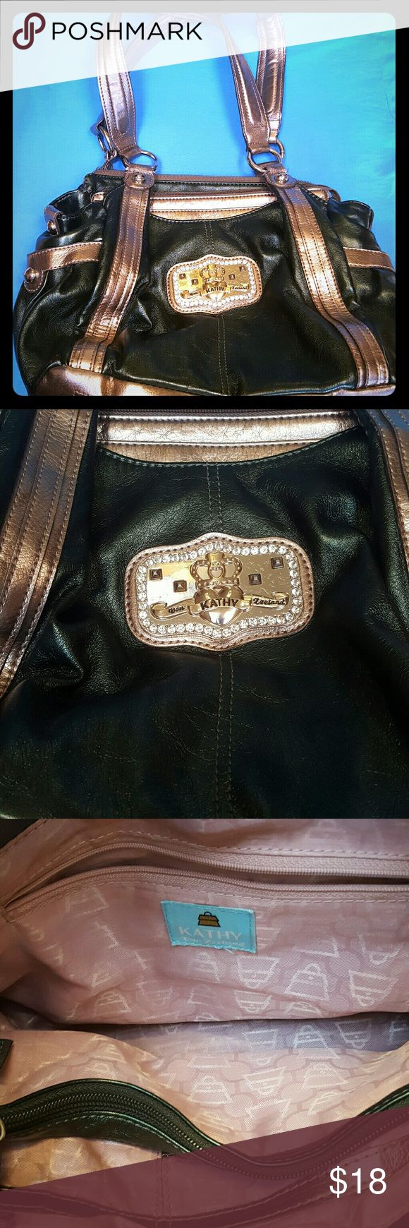 Metallic Green Kathy van Zeeland purse Pre-loved Kathy van Zeeland shoulder bag in great condition! Has multiple sections and pockets. Shows some wear on inside of handles, see picture. The rest of the bag and interior look great! Have had it in my closet unused for too long so it's looking for a new home! Kathy Van Zeeland Bags Shoulder Bags