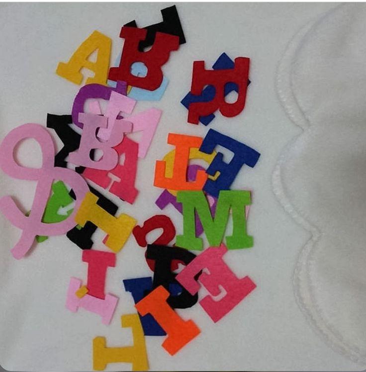 Keçe renkli harfler , elde kesim