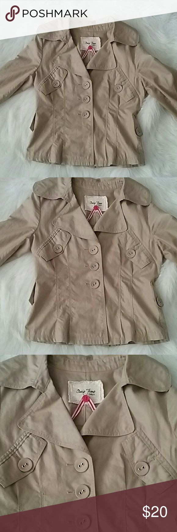 Very cute khaki short jacket large buttons Very nice 100% cotton jacket with large buttons. Large collar and real pockets in the front.  The jacket is very light and has no lining. There is a small spot on the collar included in the pictures. The buttons remind me of the Poshmark logo lol! Oasis Jeans Jackets & Coats Blazers