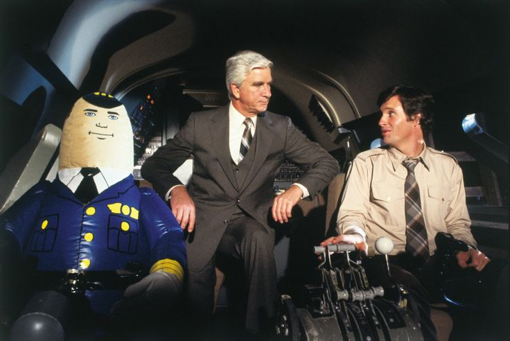 Leslie Nielsen, Robert Hays, and Otto in Airplane! (1980)