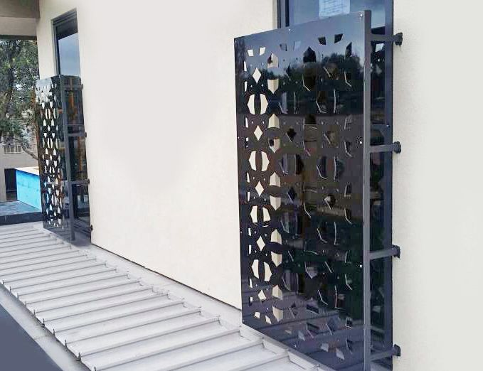 Contemporary window covers using decorative laser cut screens to create privacy and shield from the sun: a slightly customized 'Budapest' design cut in mild steel. Installed by Installation works. ~QAQ #windows #windowdecor #privacyscreens #sunscreens