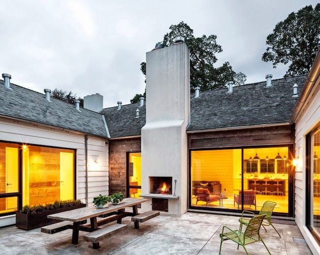Courtyard with fireplace. See the bedroom wing hallway through the window on the left.  Grey and Scout | Interior Inspiration: PORTLAND