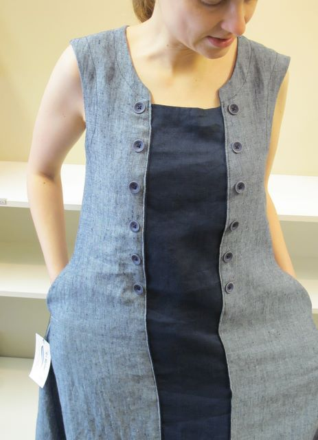 This inspires make to make too small or ill-fitted shirts and dresses fit well.  Cut and sew a strip of fabric in, and add ribbon holes or buttons and use ribbon or strong to synch it in all the right places.