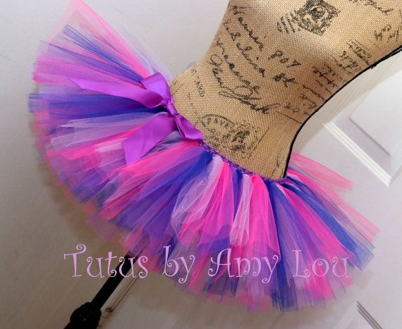 BASIC 4 Color Tutu In Purple, Royal Blue, Lavender, and Shocking Pink. I call this pattern Dreamy because it creates a very soft, delicate look. The perfect colors for your Kawaii or Cheshire Cat costume or any race or event! RUN LIKE A GIRL. This BASIC 4 color tutu is made from 100% Nylon tulle. Two layers of tulle make this tutu full and fluffy which means your tutu won't look wimpy or deflated by the end of your race. THE RUN DOWN: The tutu your see in the images above is a sample. Yours…