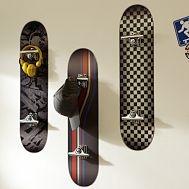 skateboard shelves- good idea to use the skateboard hardware as hooks