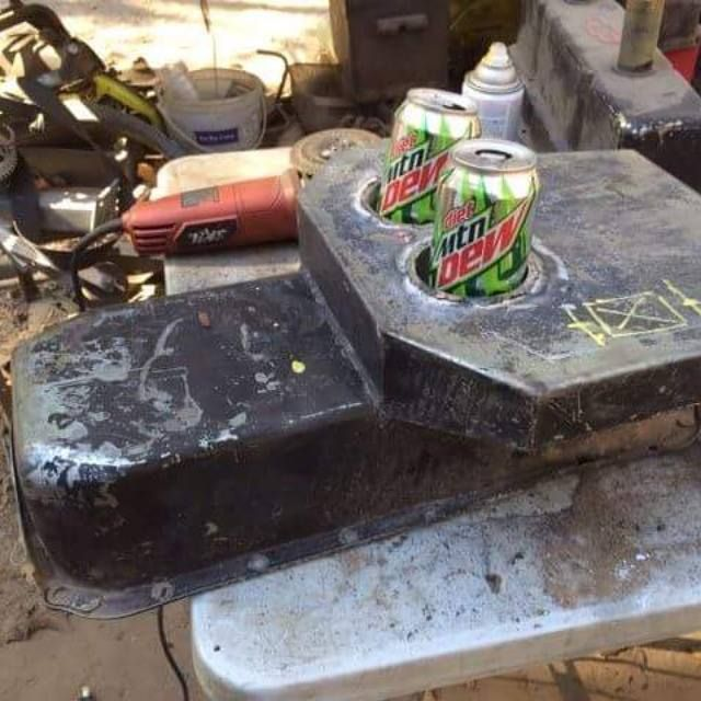 And oil pan used as a custom rat rod center console with some cup holders welded into place.