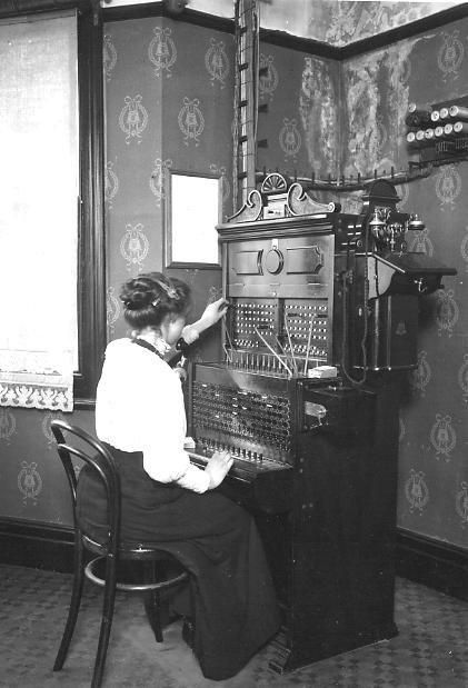 """Telefoniste ca. 1900....reminds me of the show the """"Walton's"""" where the local operator had something like this in a corner of a room..."""