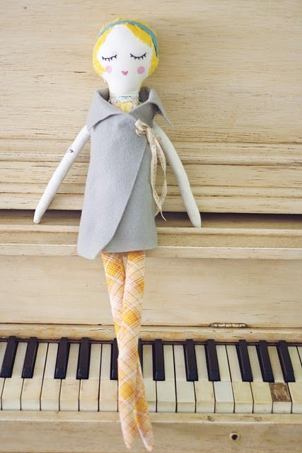 doll.. no -- she's in the way of a nice light colored beaten up up-right piano w/tacks on the hammers. mmm