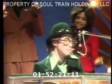"Elton John sings ""Benny and the Jets""on soul train 1975 check out the dancers! a MUST see!!!"