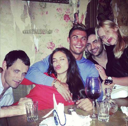 Cristiano Ronaldo holding Irina Shayk with friends by their side, on a dinner in New York