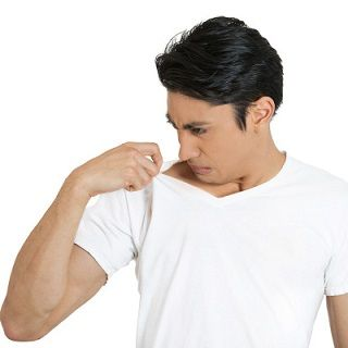 Closeup Portrait Of Unhappy Young Man Smelling Sniffing