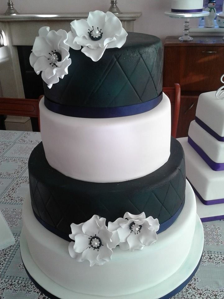 Navy and white wedding cake with white sugar flowers
