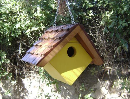 A cute little hanging wren house with a clean and simple design. Some wrenhouses have bright colors and this one has three coats of bright yellow acrylic hobby paint. It will add a cheerful look to your backyard landscape.