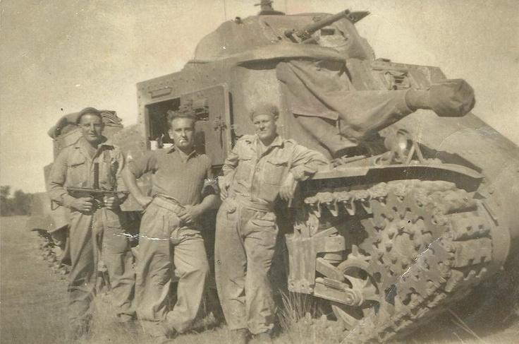 Tom Trewartha holding Owen Gun WW2