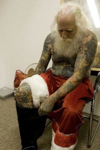Tattooed Santa.I imagine a tattooed Santa would come bearing money for new tattoos.I hope he comes to my house for Christmas