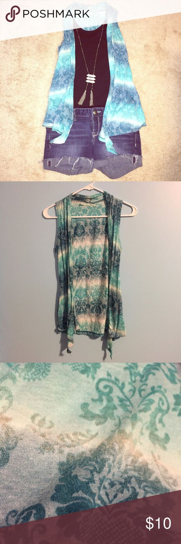 Blue Vest Patterned vest in shades of blue and white. EUC - I have this vest in shades of brown and cream NWT. Maurices Jackets & Coats Vests