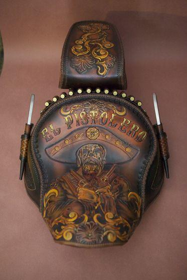 "<h1>Custom Made Motorcycle Seats</h1> <p class=""p1""><em><strong>Custom Made Motorcycle Seats </strong></em>created by Red Beard Leather<b>,</b> your place for creating quality custom hand tooled seats and leather accessories. We use the finest leather to create exceptional works that are one of a kind, and completely original. Contact us directly if you have a project in mind that you don't see in our product gallery. You can send us any art work via e-mail and we will work with you to make…"