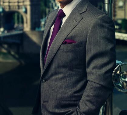 purple tie and gray suit