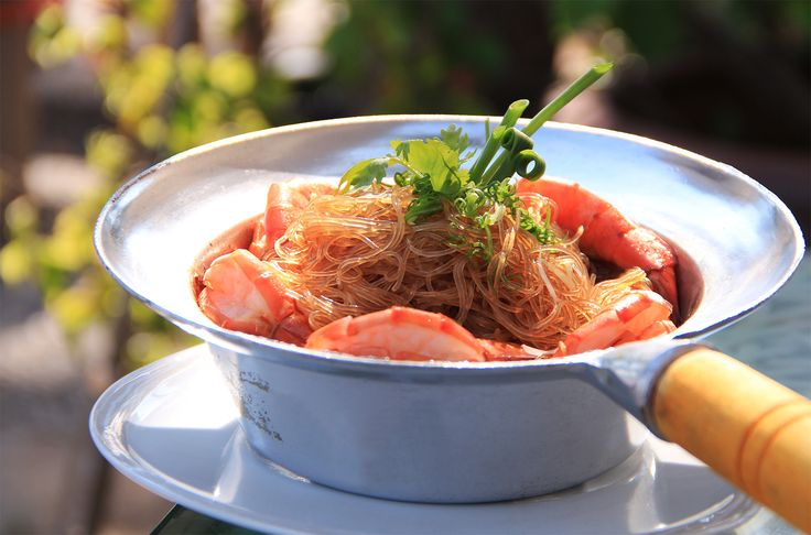 One of Thailand's famous - the noodles - are placed in a pot with soy and either seafood or prawns and then placed over a fire. Try it - it's absolutely delicious!