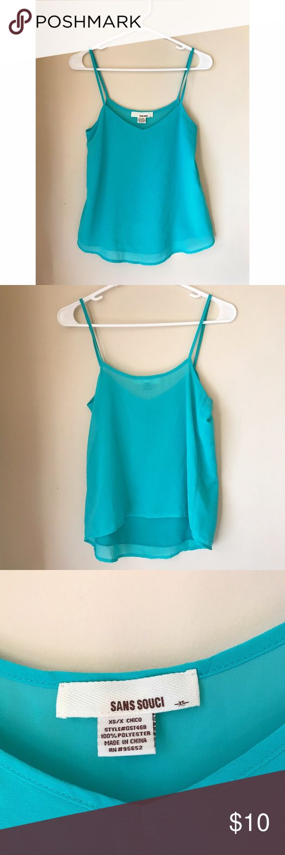 Blue Sheer Tank Blue/teal sheer tank, with a lining in the front. This shirt is more teal and less of the bright blue in the photos, I couldn't get it to photograph true to color.   Measurements laying flat: Bust: 16in Length down side: 14in  #blue #teal #sheer #tank #spaghetti #strap #thatcameragirl #medium #summer #spring Sans Souci Tops Tank Tops
