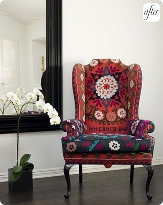 Beautiful reupholstered wing back chair. Sides are different from the rest of fabric