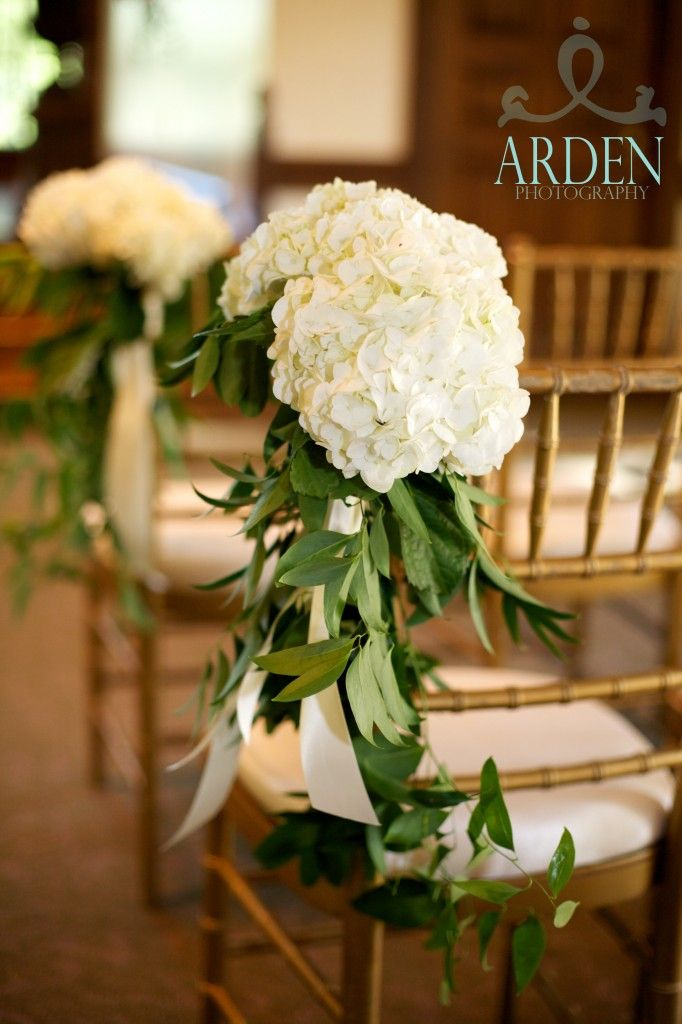pew flowers.  Arden Photography, M. Elizabeth Events