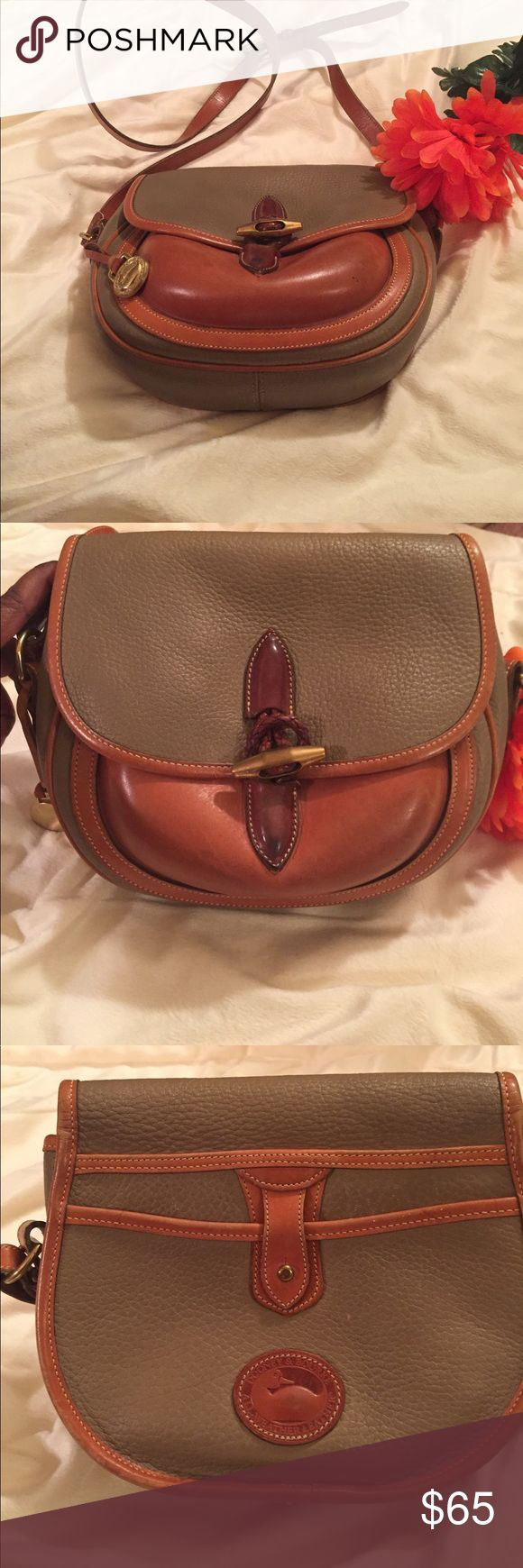 Dooney and Bourke AWL Saddle Vintage Handbag Beautiful handbag from Dooney and Bourke in the color tan. Unique outside pocket on both sides with unique closure. Inside has traditional pockets with little wear inside and outside. In excellent condition. Leather conditioning care. Handle size is 20 inches with room for extension. Dooney & Bourke Bags Shoulder Bags