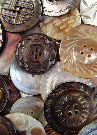 Carved vintage MOP buttons in shades of brown.