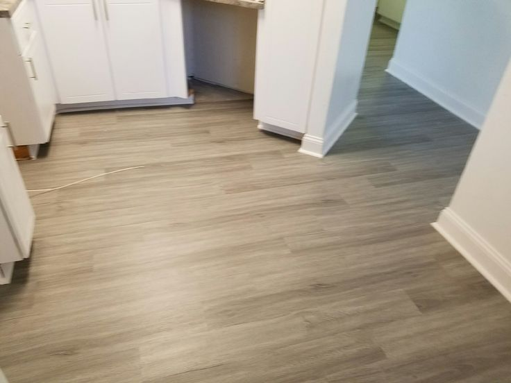 "2mm Luxury Vinyl Planks in ""Savannah Oak"". Currently being installed in a 300 unit luxury high rise in South Florida. Patriot's Provincial Series is available in a larger 6"" x 48"" plank and makes a bold statement in design, color, and character."