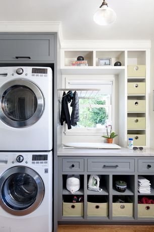 Transitional Laundry Room with LG Electronics 2.3 cu. ft. High-Efficiency Front Load Washer, Hardwood floors, Pendant Light