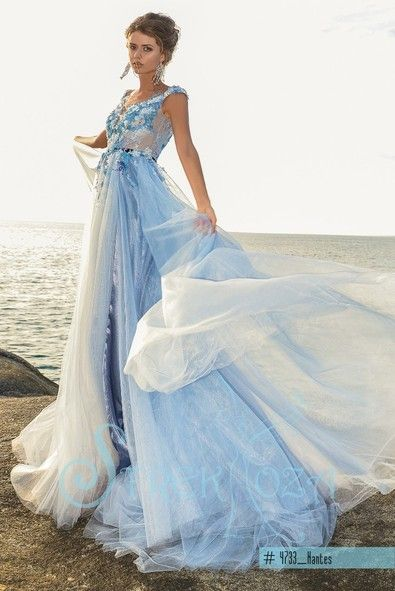 Wedding next to the beach..Perfect dress -Nantes with 3D flowers and many layers flowing skirt info@michelangela.co.za