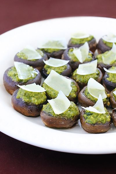 Pesto stuffed mushrooms.  Another fun and simple spring/summery appetizer.  Love me some gimmesomeoven.com!
