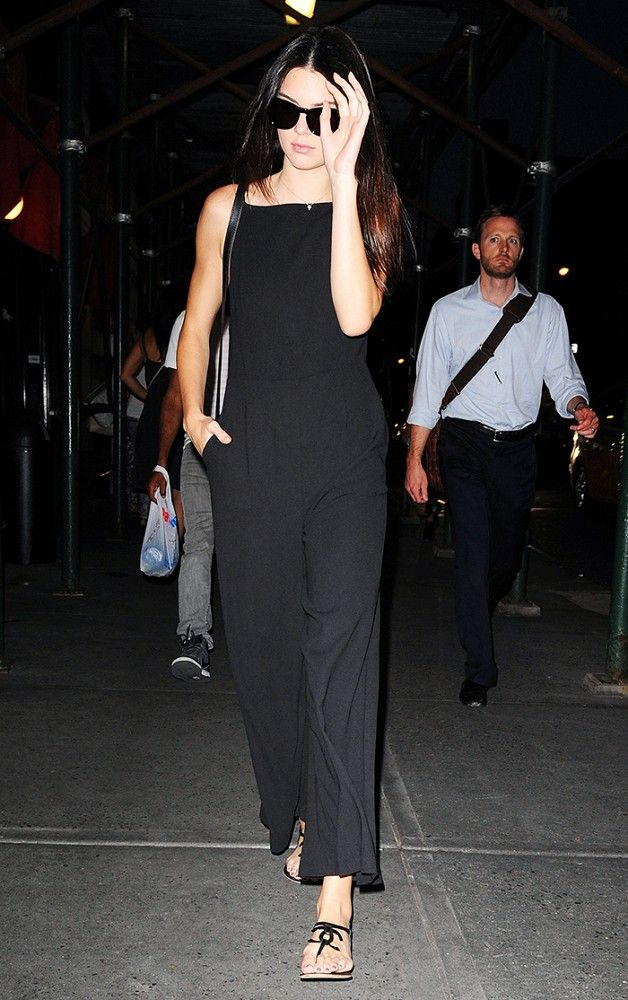 Travel in style like Kendall Jenner in a black jumpsuit and Chanel flats