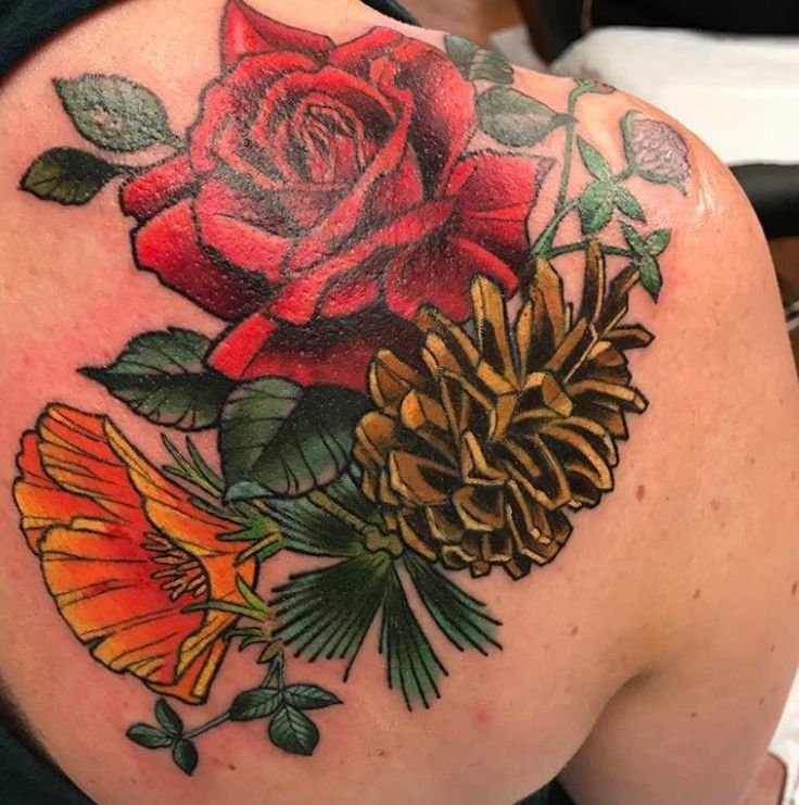 Rose and pinecone tattoo by Kim Saigh at Memoir Tattoo