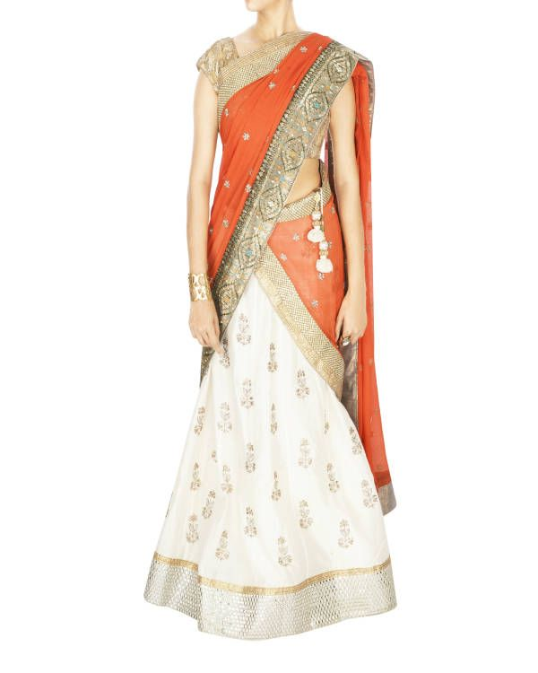 Offwhite lehanga with orange dupatta and golden blouse | Shop now: www.thesecretlabel.com