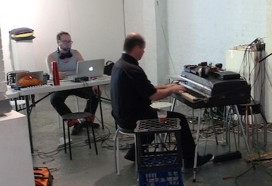 Toby Gifford and Andrew Brown practice for the Sydney hack-together concert in April at Serial Space.
