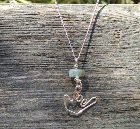 "American sign language sterling silver necklaces with ily hand shape on a 16"", 18"", or 20"" chain and a precious aquamarine stone. price: $18.00 to $24.00"