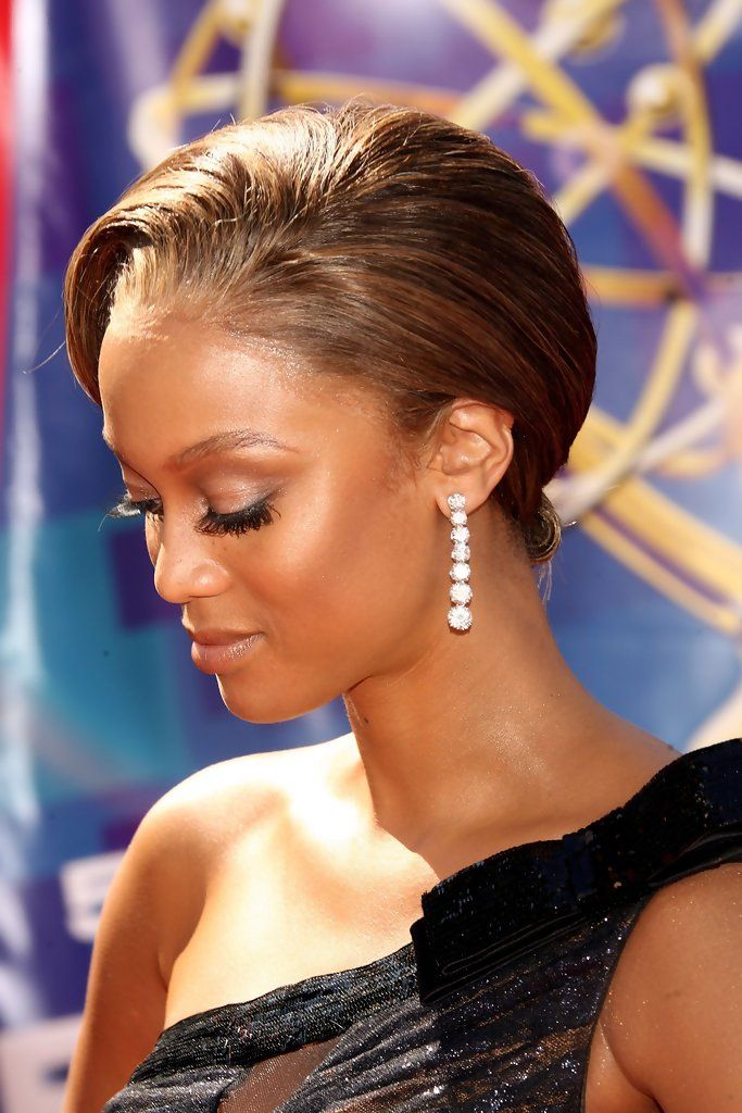 Hair Lookbook: Tyra Banks wearing Chignon (3 of 32). Tyra looked positively elegant in this romantic updo for the Emmy Awards.