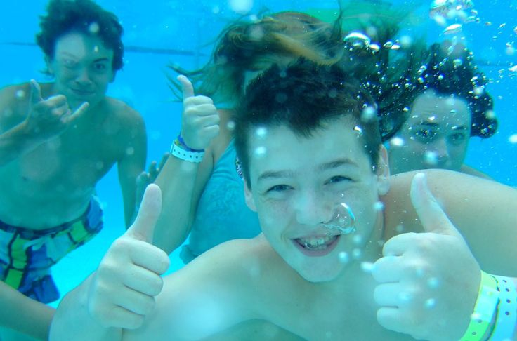 Boys underwater at River Ranch Water Park located on-site at Camp Kulaqua Retreat and Conference Center